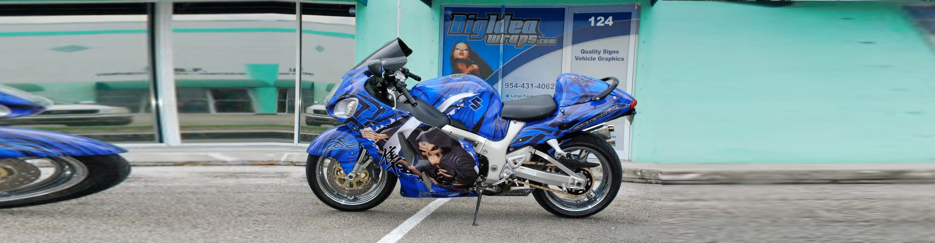 a blue motorcycle parked outside