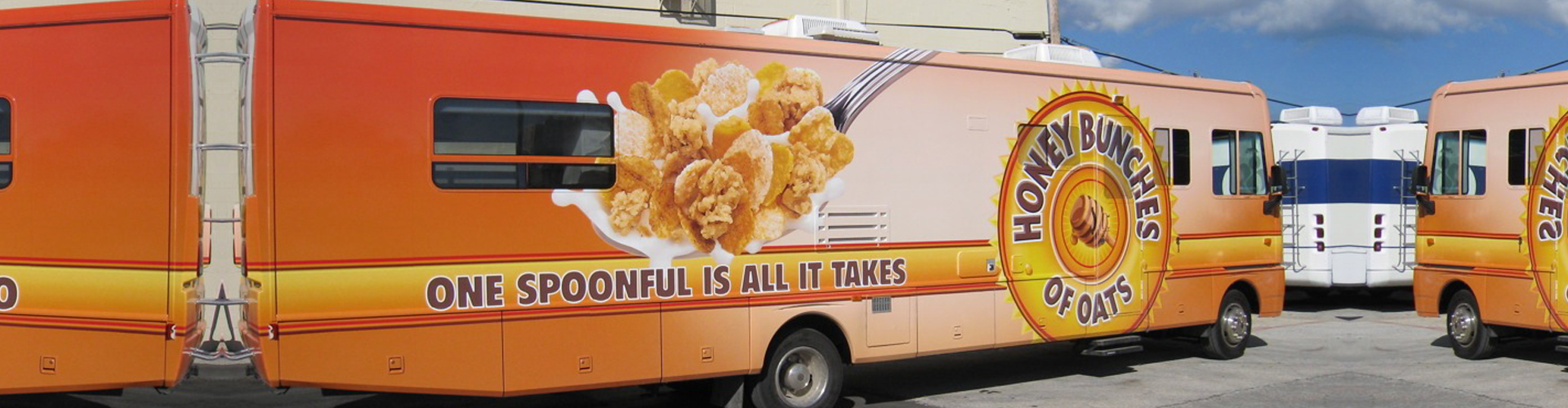 a bus with oats wrap advertising