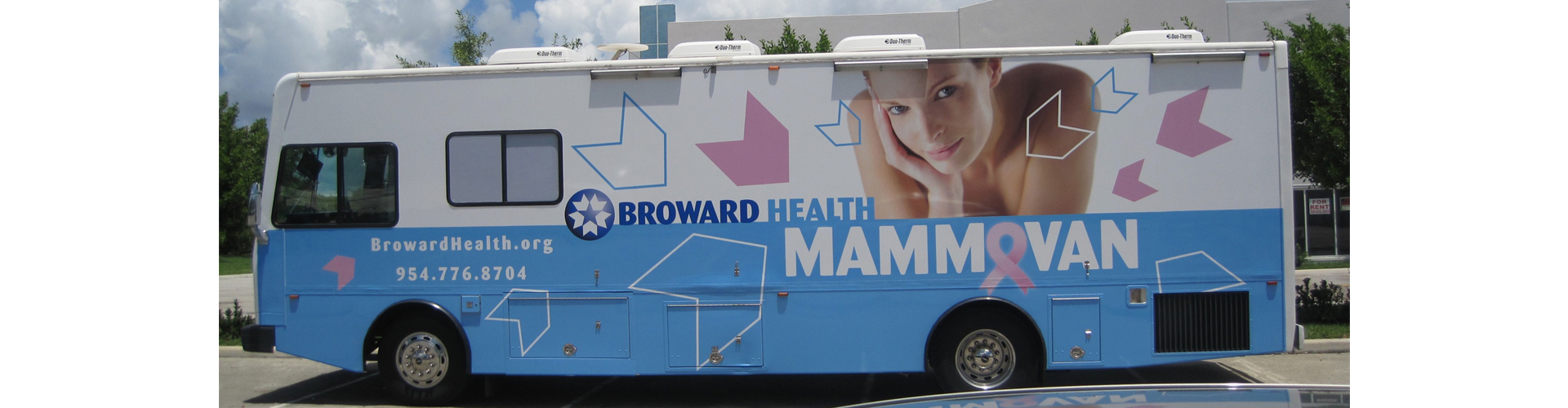 a bus with Broward Health wrap advertising